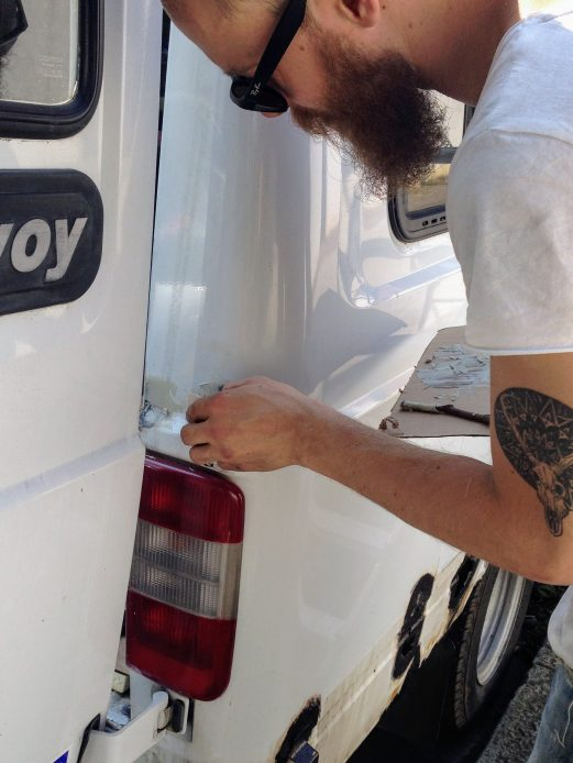 Applying body filler to treated rust areas