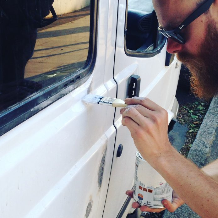 Painting over the treated rust with Hammerite Smooth White metal paint